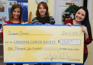 Schooley Mitchell Franchisee Success Manager Jessica Fritzley and Franchise and Business Development Specialist Julia Allum present our donation to Dianne Mohr, manager of the local branch of the Canadian Cancer Society